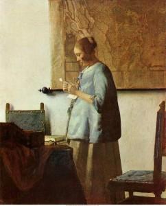 Lezende vrouw in het blauw