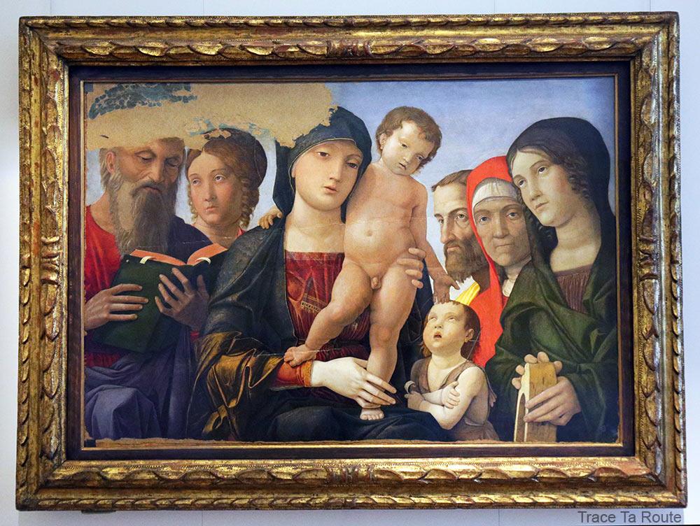 Vierge à l'Enfant avec Saint-Jean, Sainte-Catherine d'Alexandrie et les autres Saints (1488) Andrea Mantegna - Galleria Sabauda Palazzo Reale Turin